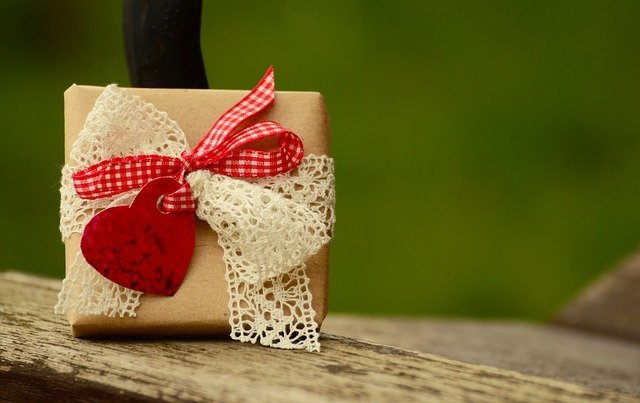 wrapped gift with a red heart and red ribbon